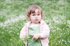 Little beautiful girl with bunch of flowers Royalty Free Stock Photography