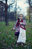 Little beautiful girl. In a checkered coat and a felt hat on nature Royalty Free Stock Photo