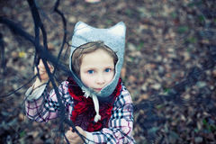 Little beautiful girl. In a checkered coat and a felt hat on nature Royalty Free Stock Photos