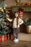 Little Beautiful Girl Decorates A Christmas Tree Royalty Free Stock Photography