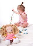 Little beautiful girl with doll Stock Images