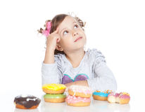 Little beautiful girl with donuts over white Royalty Free Stock Photos