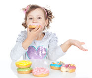Little beautiful girl with donuts  over white Royalty Free Stock Image