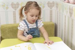 Child draws a marker royalty free stock photography