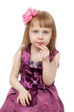 Little beautiful girl eats marmalade Stock Photos