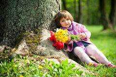 Little beautiful girl with flowers. This image has attached release Stock Photo