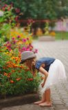 Little beautiful girl in flowers park Stock Photo