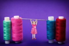 The girl for 3 years hung her hands on a large needle for sewing. royalty free stock photo