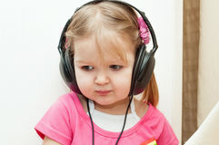 Little beautiful girl in headphones Royalty Free Stock Image