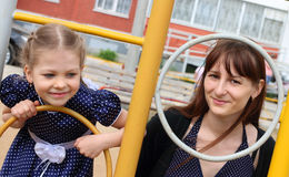 Little beautiful girl and her mother plays on playground Royalty Free Stock Images