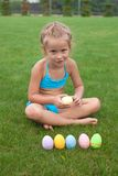 Little beautiful girl holding an Easter egg Stock Photos