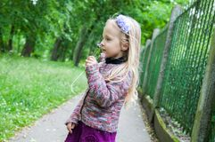 Little beautiful blond girl on the road Stock Photo