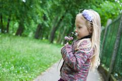 Little beautiful blond girl in nature stock photography