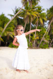 Little beautiful girl in a long dress on tropical Stock Photos