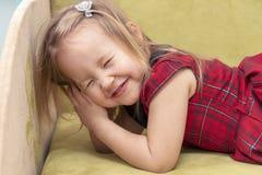 Little girl closed her eyes stock image