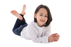 Little beautiful girl lying isolated on white Royalty Free Stock Photos