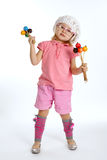 Little beautiful girl with maracas Stock Photo