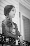 Little beautiful girl near handrail Stock Photo