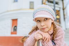 Little beautiful girl near handrail. Little beautiful smiling girl in cap near handrail stock photos