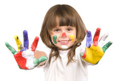 Little beautiful girl and paint. The small beautiful girl has stretched to a camera of a palm soiled in a paint of different colors, smiles, closeup, on white Royalty Free Stock Photo