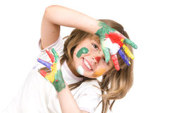 Little beautiful girl and paint. The small beautiful girl has stretched to a camera of a palm soiled in a paint of different colors, smiles, closeup, on white Royalty Free Stock Images