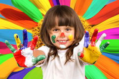 Little beautiful girl and paint Royalty Free Stock Photography
