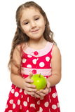 Little beautiful girl in pink clothes green apple Royalty Free Stock Image