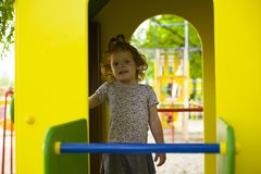 Little beautiful girl is played on the playground stock photo