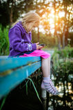 Little beautiful girl read e-books Royalty Free Stock Photo