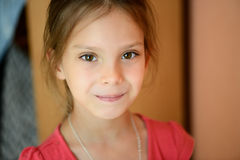 Little beautiful girl in red blouse Royalty Free Stock Image