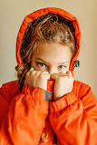 Little beautiful girl in red jacket Royalty Free Stock Photography