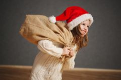 Little beautiful girl with red santa hat stock image
