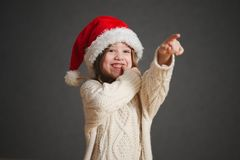 Little beautiful girl with red santa hat royalty free stock image