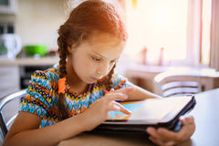 Little beautiful girl running on the tablet PC Royalty Free Stock Photography