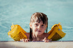 Little beautiful girl swims and dives to the pool. Little girl swims and dives to the pool Royalty Free Stock Photography