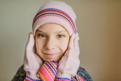 Little beautiful girl in winter hat and scarf Stock Photos