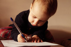 Little beautiful girl writing in her book Royalty Free Stock Image