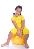 Little beautiful girl in yellow with yellow ball Royalty Free Stock Photography