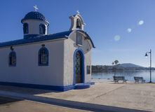 Little beautiful Greek church in blue and white colors on a sunny day against the blue sky on the island of Evia, Greece stock images