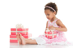 Little beautiful mulatto girl with a gift in their hands Stock Images