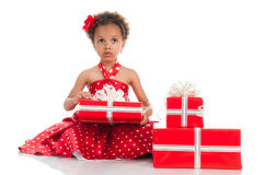 Little beautiful mulatto girl with gifts Stock Photos