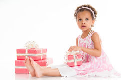 Little beautiful mulatto girl with gifts Royalty Free Stock Image