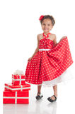 Little beautiful mulatto girl with gifts. Stock Photos