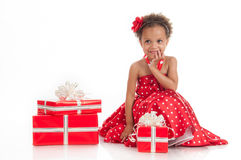 Little beautiful mulatto girl with gifts. Royalty Free Stock Image