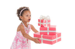 Little beautiful mulatto girl with gifts. Royalty Free Stock Photo