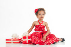 Little beautiful mulatto girl with gifts Royalty Free Stock Photos