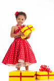 Little beautiful mulatto girl with gifts Royalty Free Stock Photography