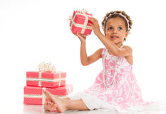 Little beautiful mulatto girl with gifts Stock Photo