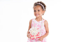 Little beautiful mulatto girl with gifts Stock Photography