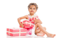 Little beautiful mulatto girl with gifts Royalty Free Stock Photo